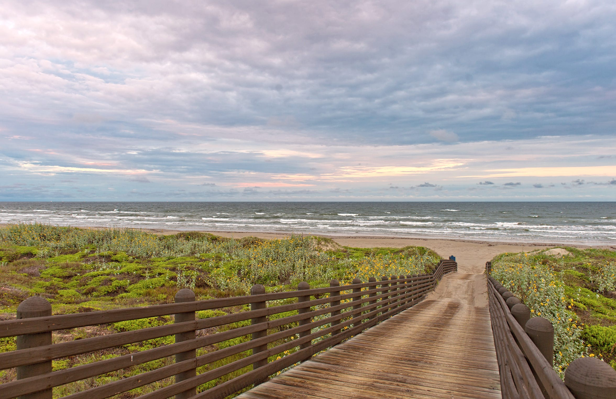 Cinnamon Shore's walkway to the beach is just steps away.