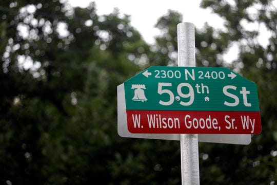 A newly-installed street sign honoring former Philadelphia Mayor W. Wilson Goode Sr. is seen Friday Sept. 21, 2018 in the Overbrook section of Philadelphia. During a Friday ceremony, Goode said he was responsible for dropping a bomb on a home full of people 33 years ago, but said he would not be defined by one day of his life_ the 1985 police bombing of the MOVE headquarters that killed 11 people and destroyed more than 60 rowhomes.(AP Photo/Jacqueline Larma)