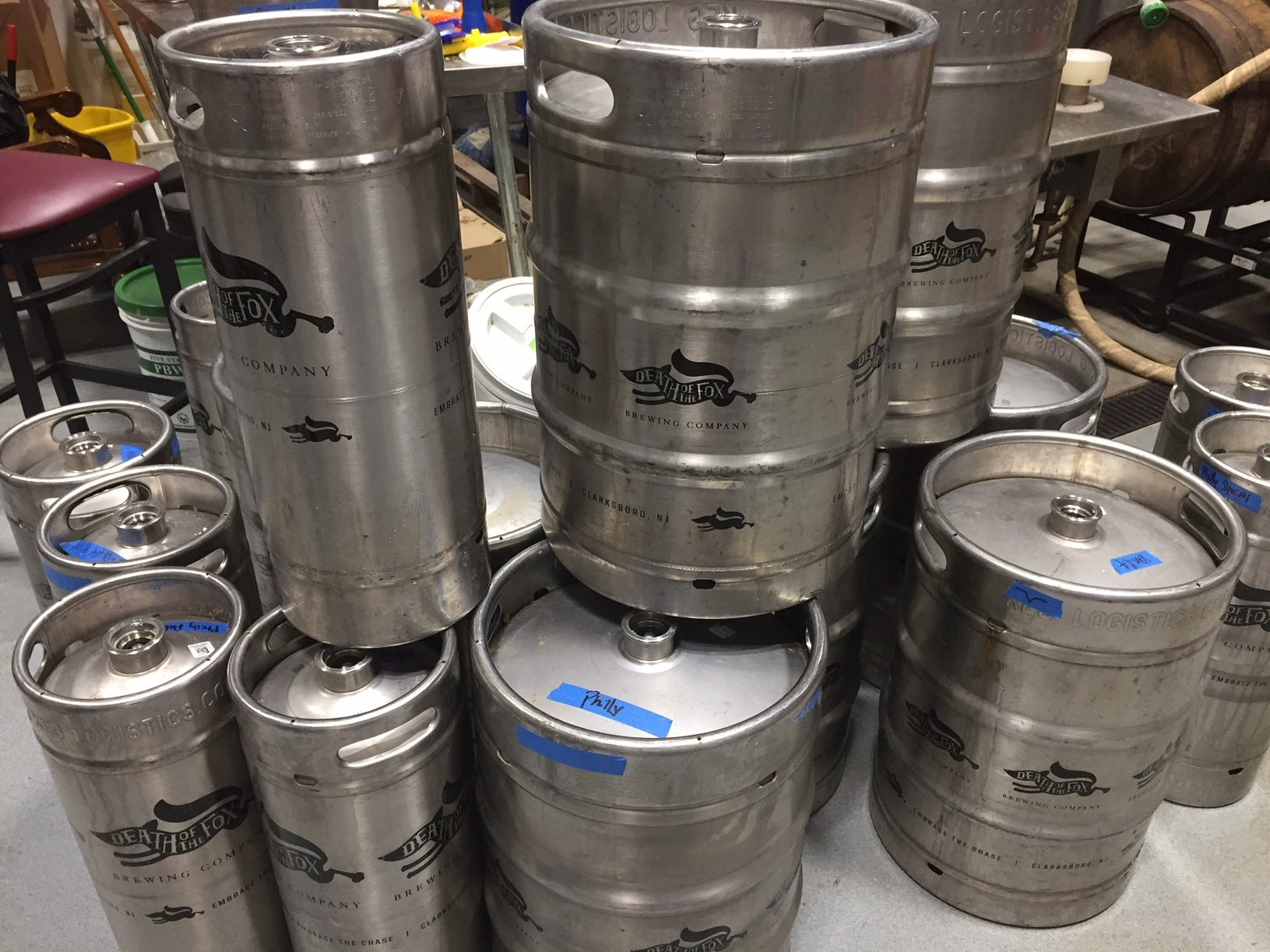 Kegs of Death of the Fox stand stacked in the brewing area of the East Greenwich Township brewery and coffee house. The brewery serves in the tasting room daily, as well making their beer available to bars and restaurants.
