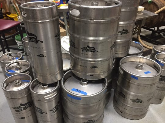 Kegs of Death of the Fox stand stacked in the brewing area of the East Greenwich Township brewery and coffee house.