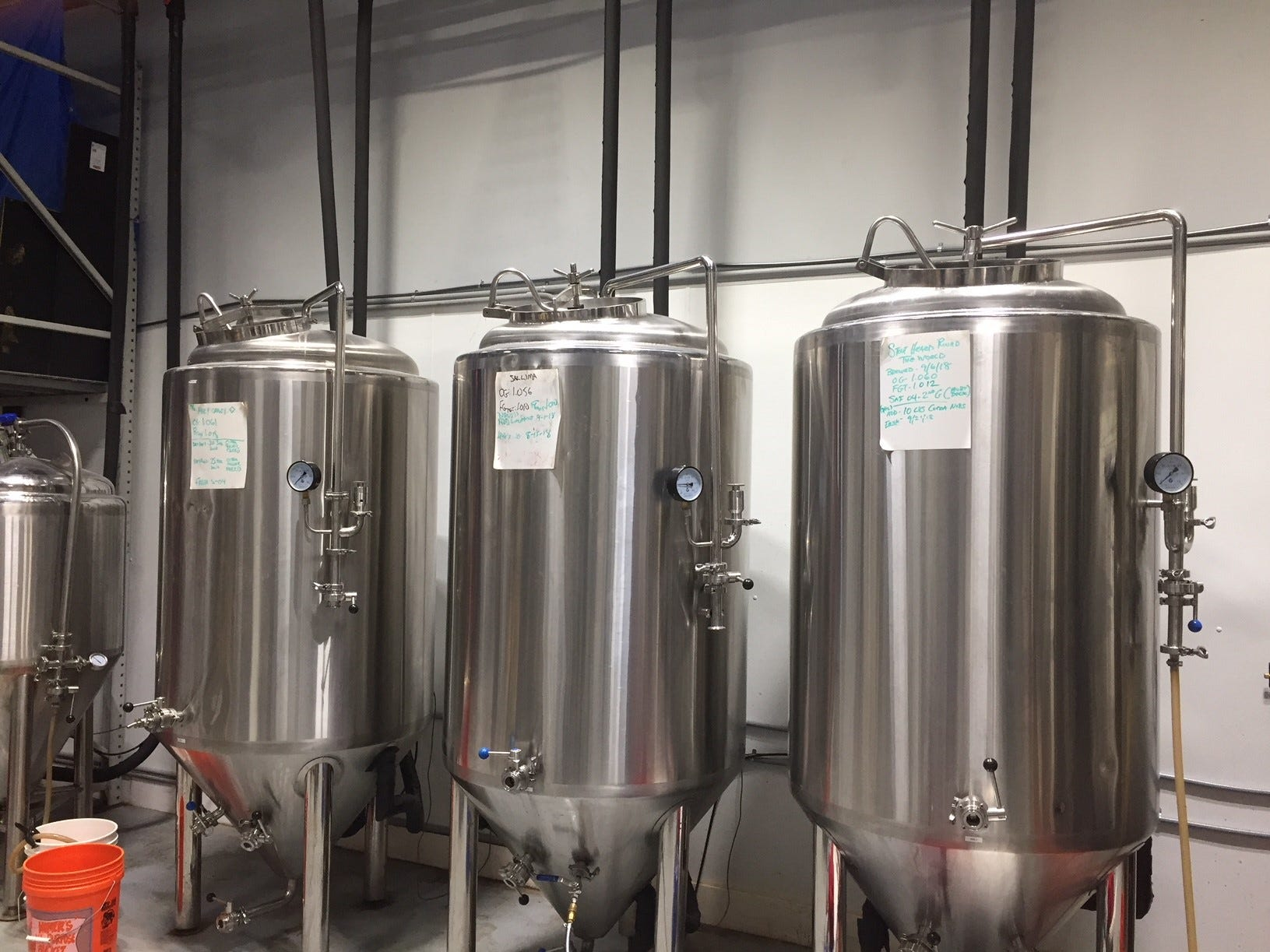Three kinds of Death of the Fox beer mature in the brite tanks of the brewery.
