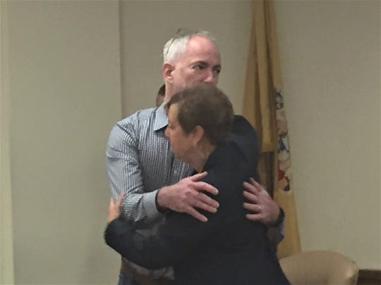Mark Parker of Westmont hugs defense attorney Jill Cohen after his sentencing hearing on Friday.