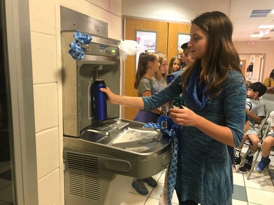 Casey Leo, a Pleasant Valley School fifth grader in Harrison Township, is among the first students participating in the inaugural fills from the water bottle filling station. Her class worked to convert classmates to refillable bottles instead of single-use plastic.