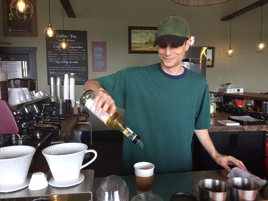 Barista/bartender Lance Feltman of  West Deptford makes a vanilla latte at Death of the Fox Brewing Company, which features locally roasted and other coffees, teas and more.