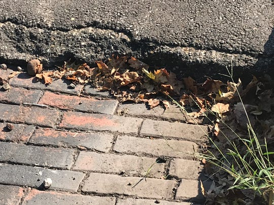 The brick pavers on West 2nd Street sit considerably lower than the asphalt-paved Walnut Street they intersect with.