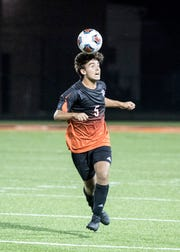 Jose Secudero heads the ball to try and get it away from Unioto Thursday night against Unioto High School.