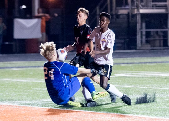 Unioto's Vijay Wangui kicks the ball into the face of Waverly goalie Levi Moore during a 6-1 win over Waverly in 2018.