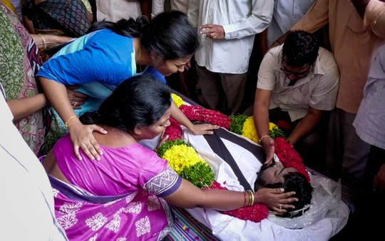 Prudhvi Raj Kandepi's mother, father and younger sister grieve the loss of their son and brother as they begin the Hindu funeral rituals outside their home in Tenali in the state of Andhra Pradesh in India on Wednesday, September 12, 2018.