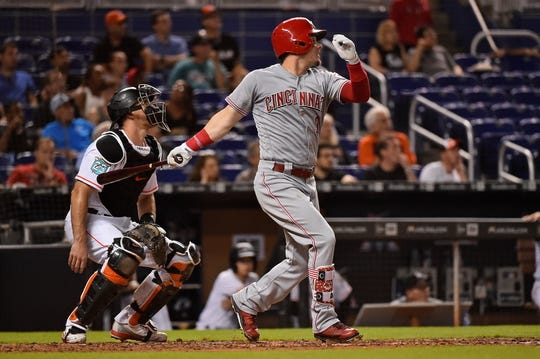 Sep 20, 2018; Miami, FL, USA; Cincinnati Reds second baseman Scooter Gennett (3) doubles in two runs in the third inning against the Miami Marlins at Marlins Park. Mandatory Credit: Jasen Vinlove-USA TODAY Sports