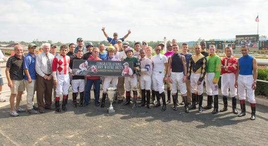 Belterra Park jockey Perry Ouzts rode his way into the history book Friday with his 7,000th win, a number only eight other jockeys have ever reached.