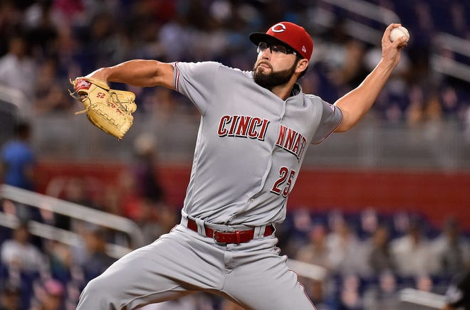 Sep 20, 2018; Miami, FL, USA; Cincinnati Reds starting pitcher Cody Reed (25) delivers a pitch in the first inning against the Miami Marlins at Marlins Park. Mandatory Credit: Jasen Vinlove-USA TODAY Sports