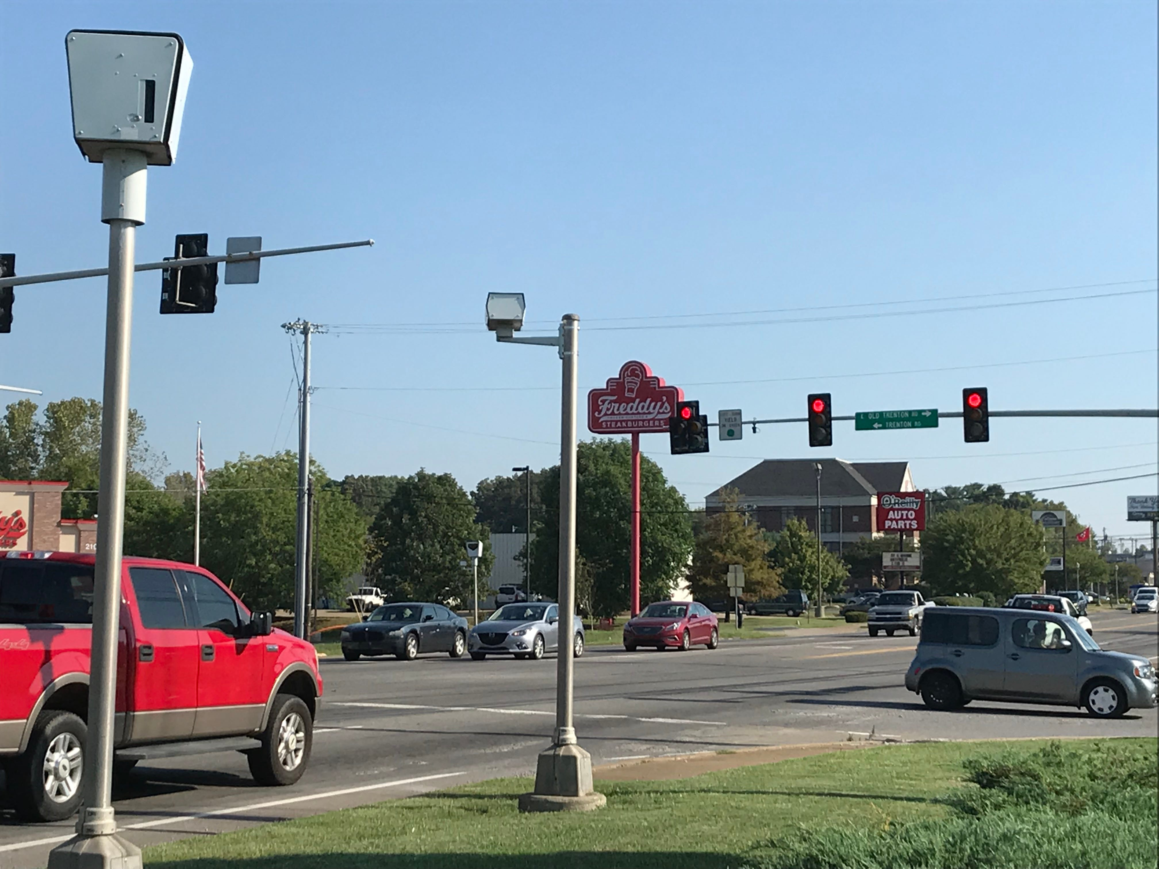 Cars waiting for a traffic signal to change under the watch of the red-light cameras at Wilma Rudolph Boulevard and Trenton Road.