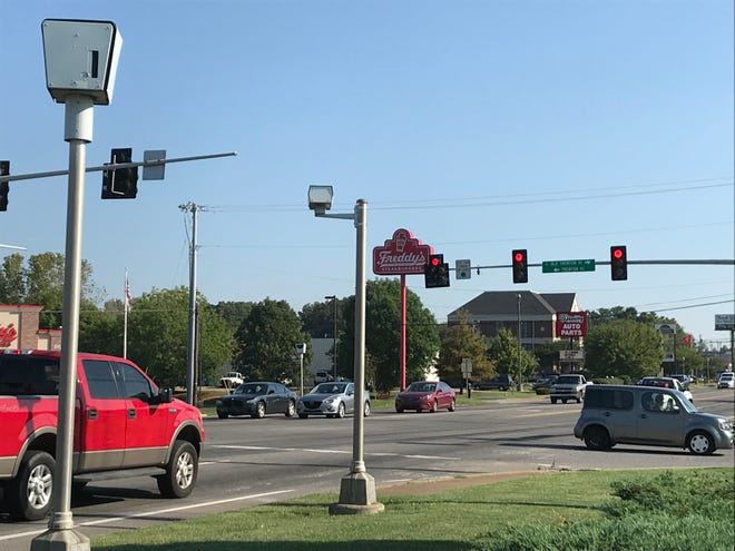 Drivers waiting for a traffic signal to change under the watch of the red-light cameras in Clarksville.
