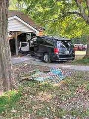 A woman was injured Friday after she accidentally crashed her van into a house.