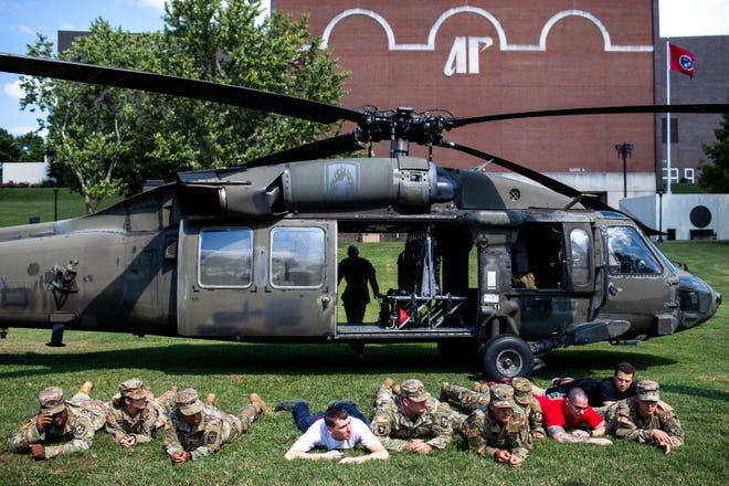 Governors Guard ROTC members drop to the ground outside of a Tennessee National Guard Black Hawk helicopter for a training exercise at Austin Peay State University Friday, Sept. 21, 2018, in Clarksville, Tenn.