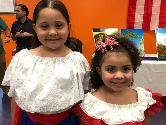 Jamilex Acosta, 9, and her sister Gianna, 5, at the Puerto Rican Association for Human Development's day of reflection in Perth Amboy on the first anniversary of Hurricane Maria in Puerto Rico.