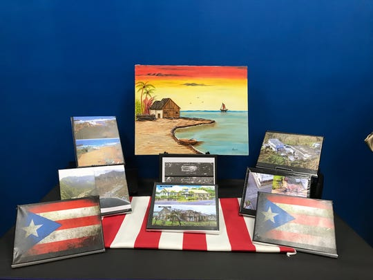 Art work of Puerto Rico on display at the Puerto Rican Association for Human Development in Perth Amboy for their event Thursday reflecting on the one year anniversary of Hurricane Maria.