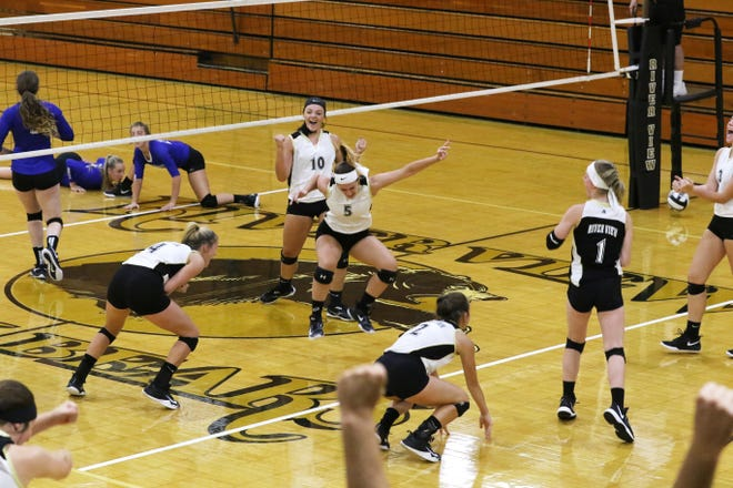 The River View High School volleyball team celebrates a victory. The program is celebrating its 50th anniversary on Saturday