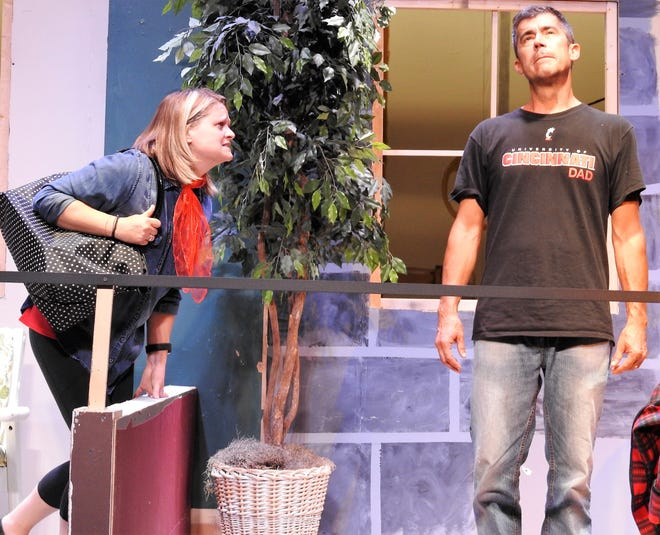 """Katie Aggas as aspiring actress and singer Angel begs her neighbor John, played by Jeff Wherley, to help her rehearse a play in """"Here on the Flight Path"""" opening at the Triple Locks Theater."""