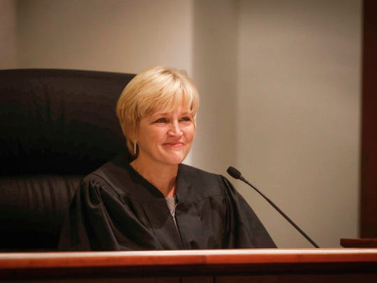 New Iowa Supreme Court Justice Susan Larson Christensen smiles after being robed during her investiture on Friday, Sept. 21, 2018, at the Iowa Supreme Court building in Des Moines.