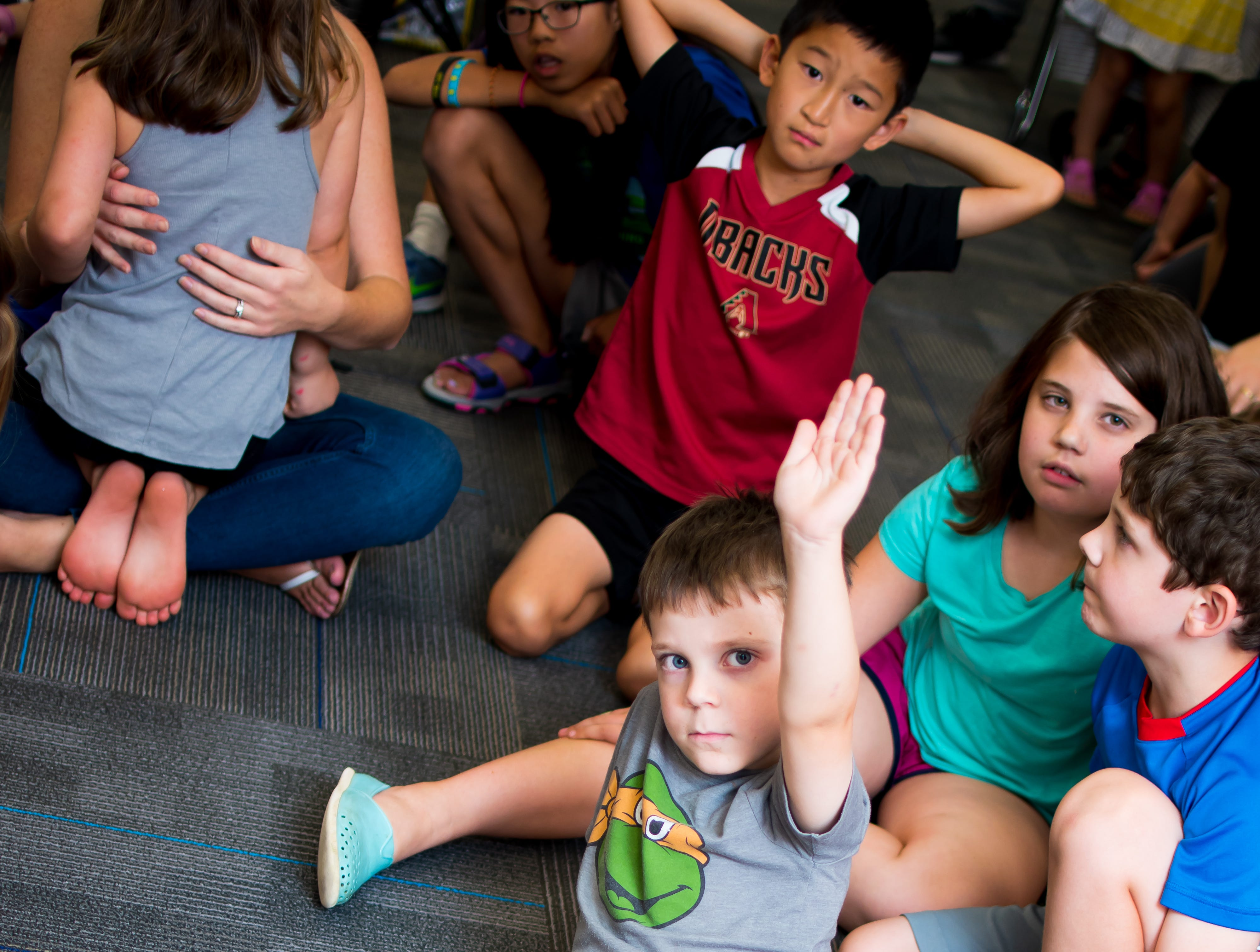 Colin Jensen, 5, of Clive raises his hand to ask a question on Thursday, September 20, 2018 at the Clive Public Library's Zoo Show and Tell in Clive.