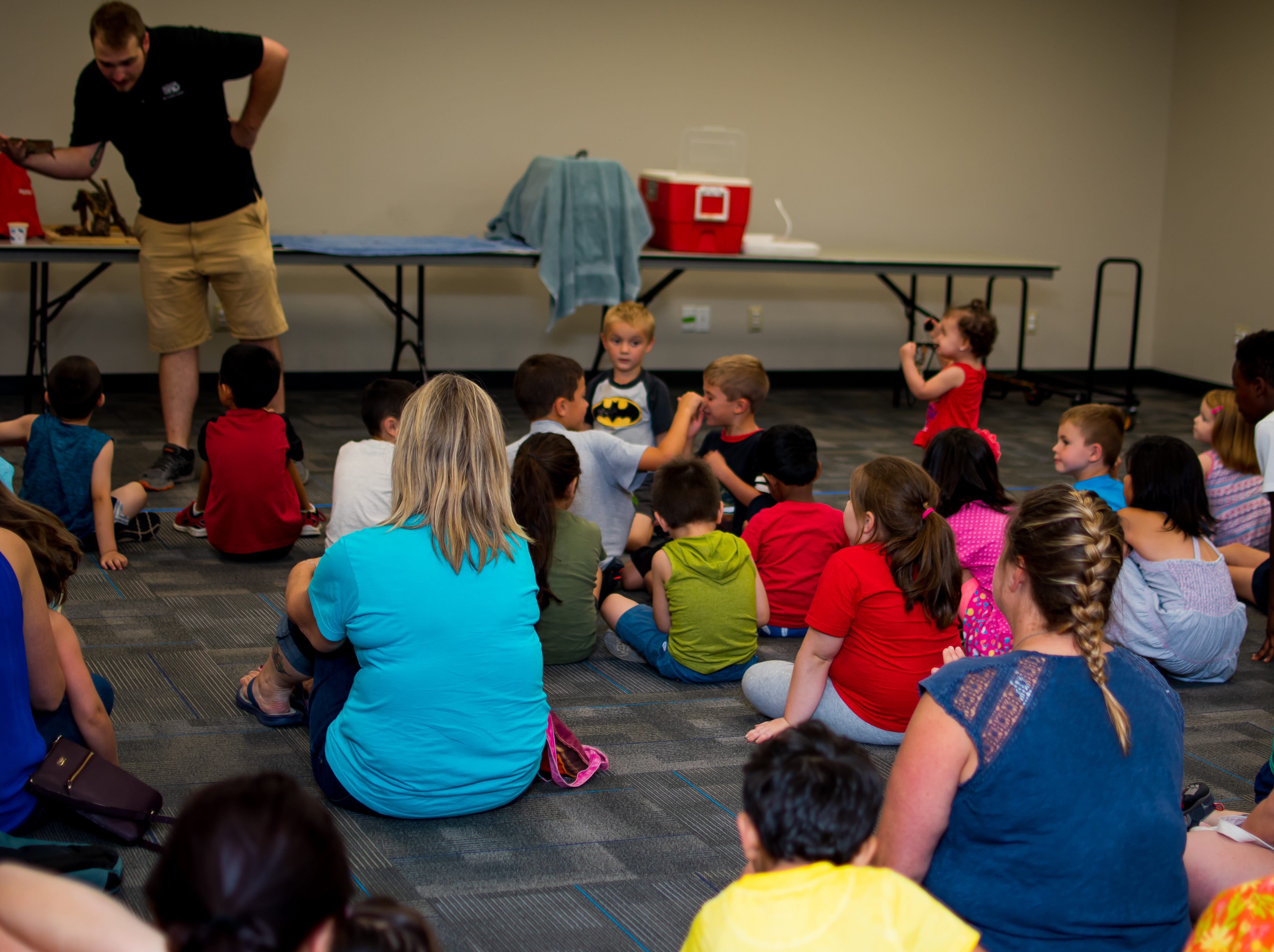 Families from Clive and the surrounding area attend Thursday Night Fun Presents Zoo Show and Tell at the Clive Public Library's Zoo Show and Tell in Clive.
