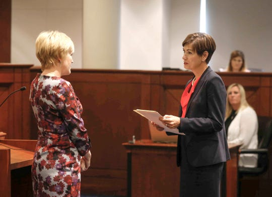 Iowa Gov. Kim Reynolds swears in Susan Larson Christensen as Iowa's newest Supreme Court Justice on Friday, Sept. 21, 2018, at the Iowa Supreme Court building in Des Moines.