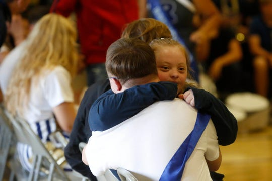 Roosevelt junior Joy Rector gives Daniel Custis a hug Friday, Sept. 21, 2018, after the two students with Down syndrome were named Prince and Princess by their peers during a homecoming assembly at Roosevelt High School in Des Moines.