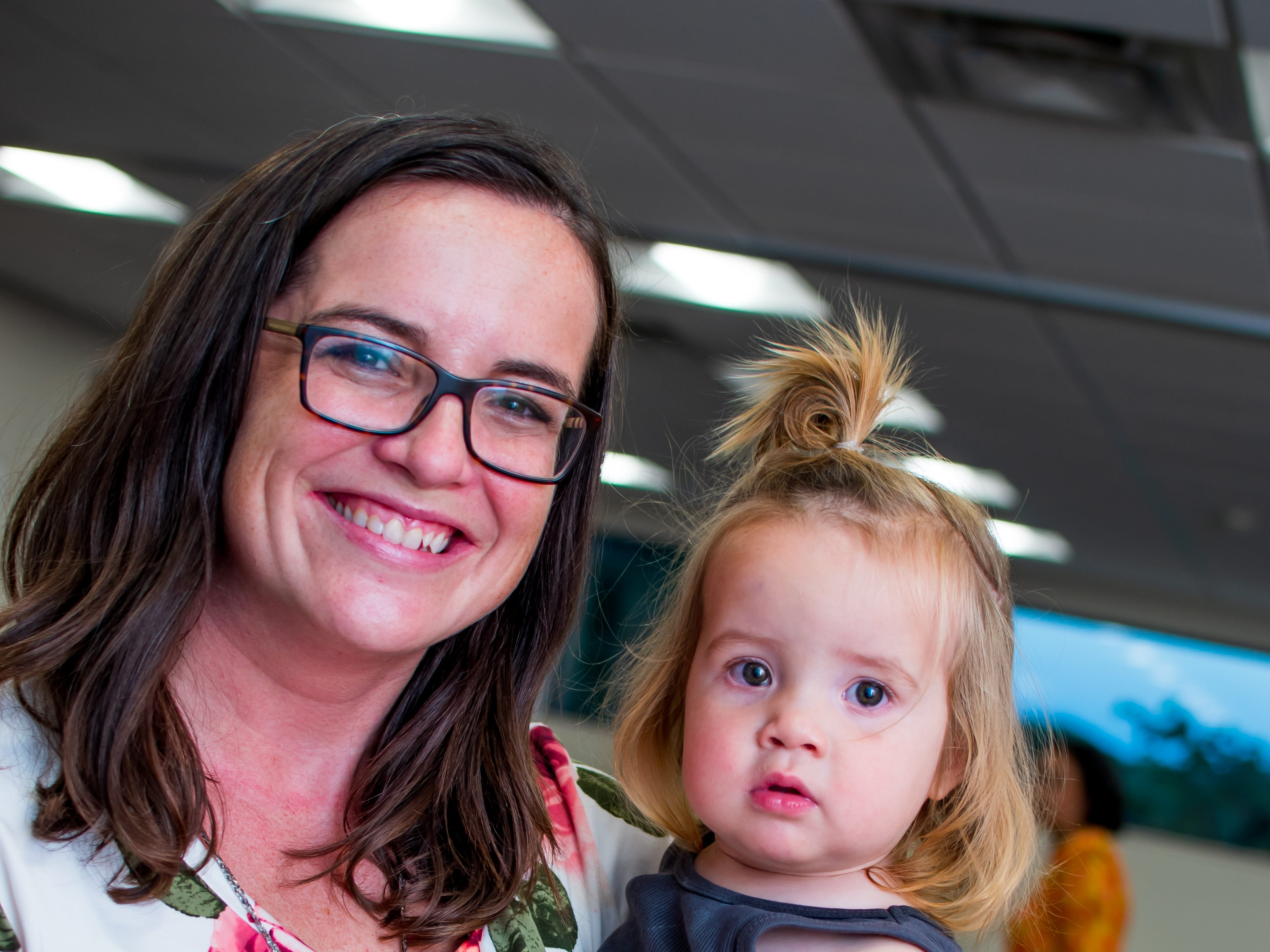 Kristi Harshbarger, and Margot Reis, 1, both of Waukee, are all smiles on  Thursday, September 20, 2018 at the Clive Public Library's Zoo Show and Tell in Clive.