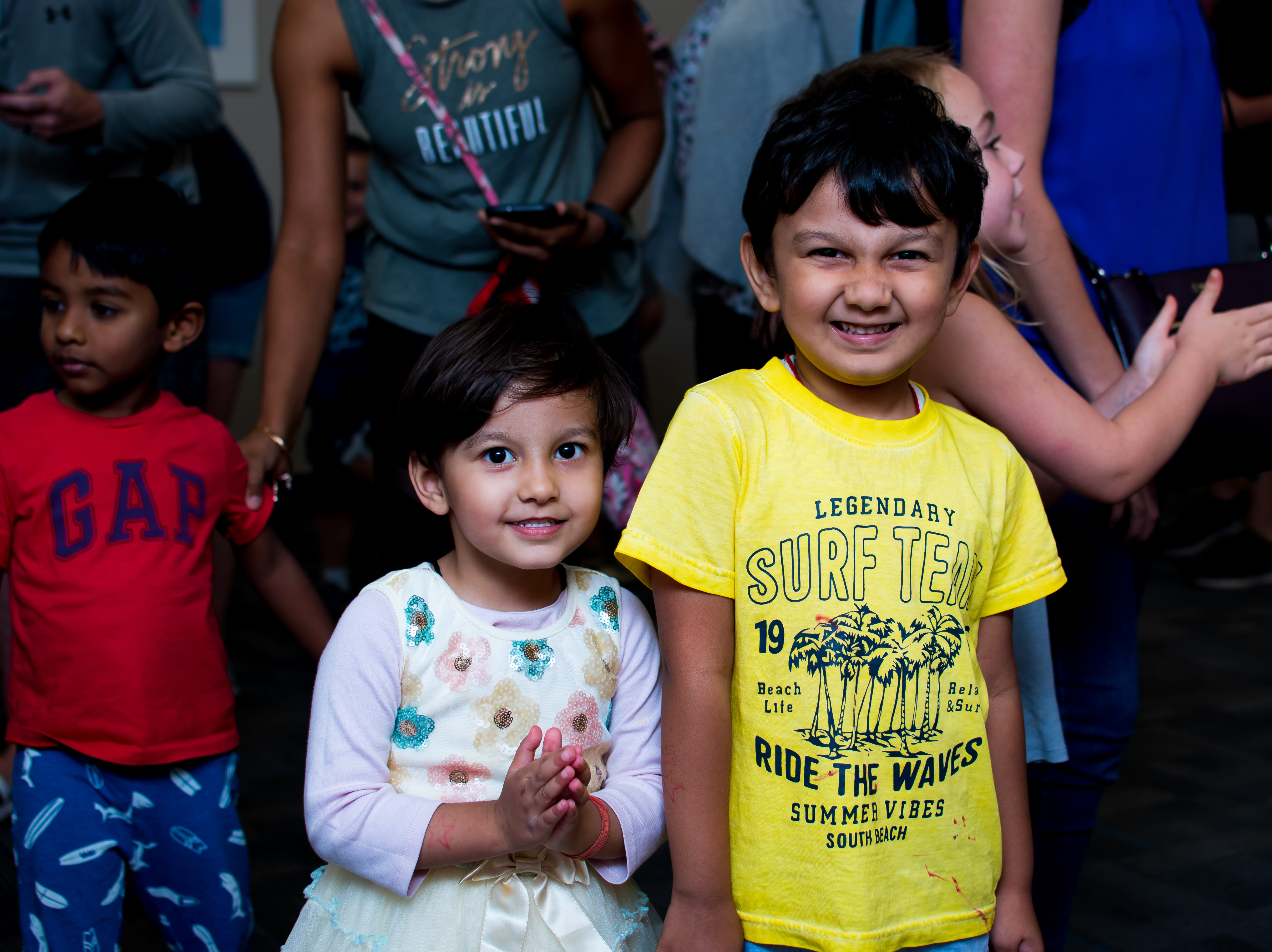 Samskara Sinha, 4, and Samskriti Sinhaon, 2, both of West Des Moines are all smiles on  Thursday, September 20, 2018 at the Clive Public Library's Zoo Show and Tell in Clive.