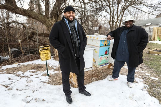 Keith Crispen, left, and Timothy Paule, both of Detroit, started a non-profit called Detroit Hives that transformed a vacant lot on the east side of Detroit to a bee hive and future farm. They are photographed on the property they received through the Detroit Land Bank Authority in March 2018.