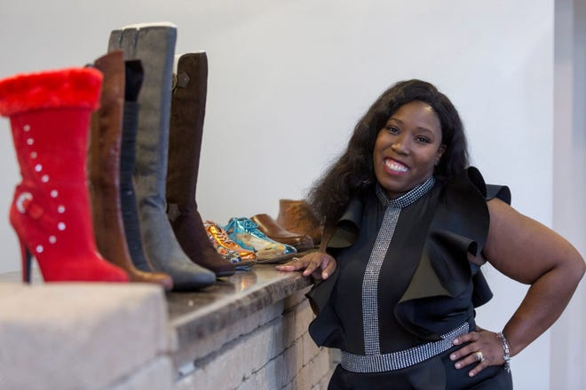 Ayanna Williams-Jones owner of Pedicures & Shoes 2 Go poses is a recipient of the Motor City Match program. Her shop is on Jefferson Ave. east of downtown Detroit.
