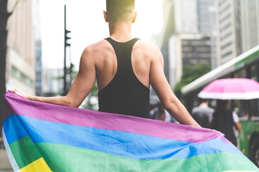 Man Holding Rainbow Flag