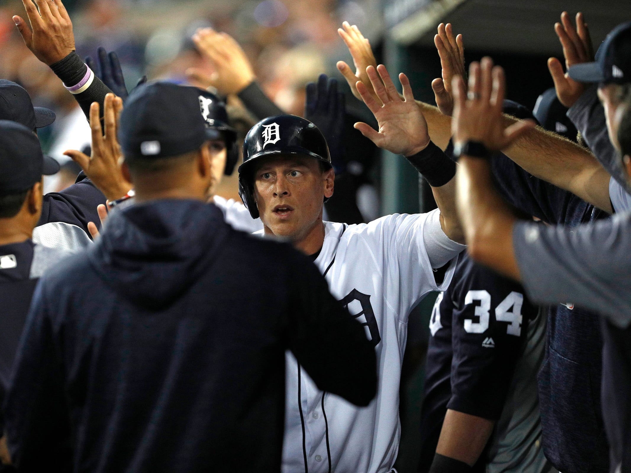 Detroit Tigers right fielder Jim Adduci celebrates with teammates in the dugout during the first inning against the Kansas City Royals at Comerica Park on Thursday, Sept. 20, 2018, in Detroit.