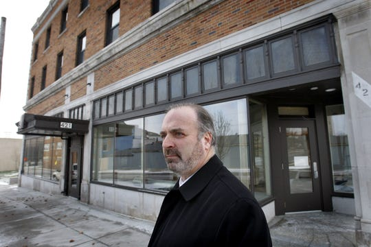 Dan Kildee stands outside the remodeled Berridge Hotel in Flint in December 2009. The longtime Democratic politician, who helped create the Genesee County Land Bank in 2002, says the new center's Flint office appropriately will occupy space in a historic downtown hotel that the land bank helped bring back from the brink.