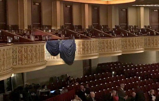 A spotlight shown over David DiChiera's box adorned with a black curtain banner at the Detroit Opera House during his public visitation and funeral service on Friday, Sept. 21, 2018 in Detroit.