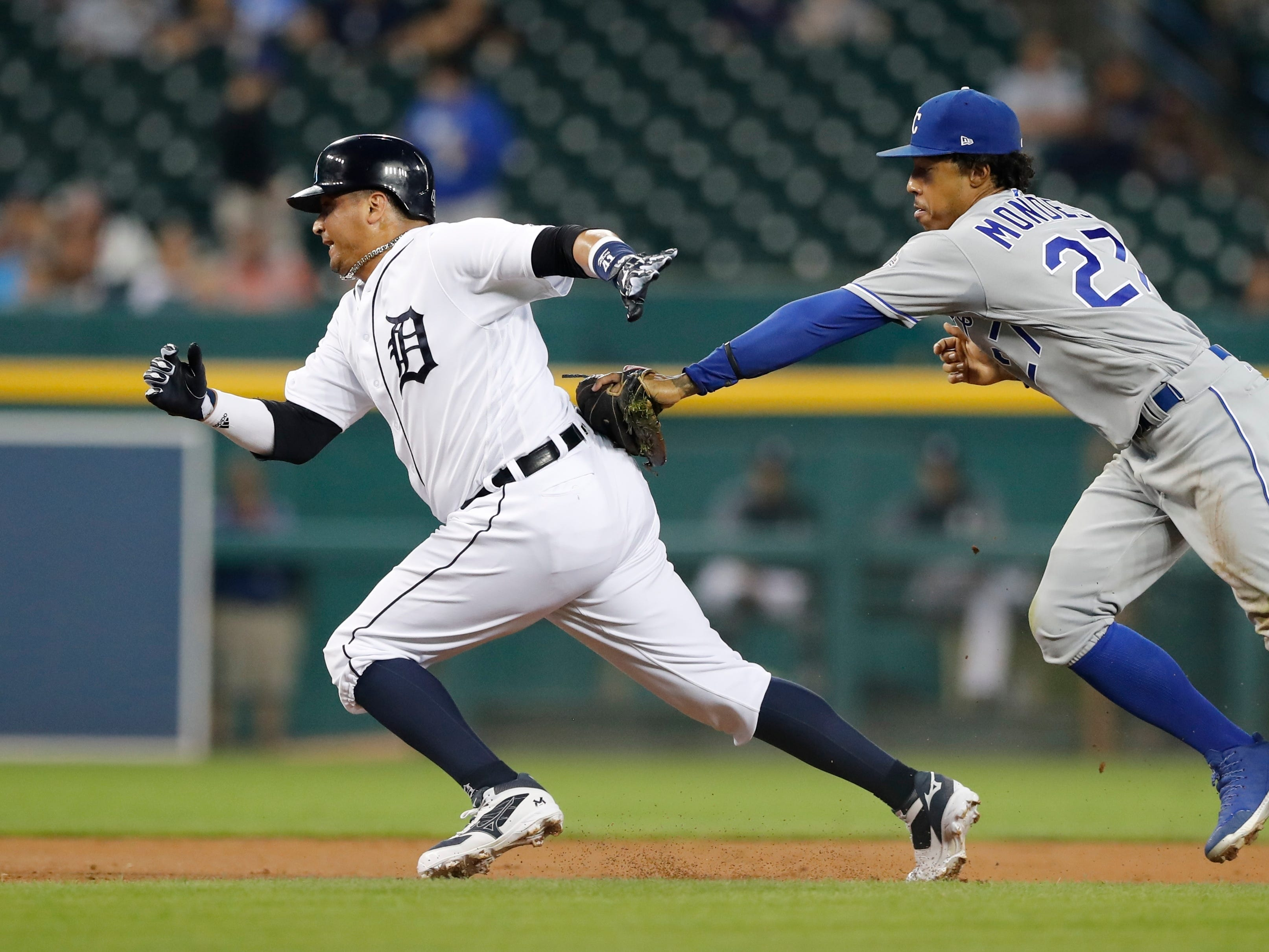 Detroit Tigers' Victor Martinez is caught in a rundown by Kansas City Royals second baseman Adalberto Mondesi during the first inning Thursday, Sept. 20, 2018, in Detroit.