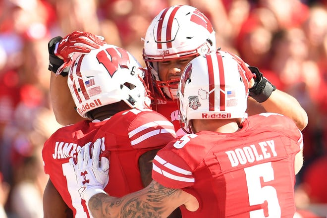 Wisconsin's T.J. Edwards (center) could be an intriguing draft prospect for the Lions next April.