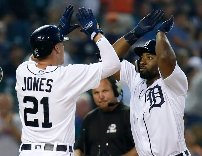 Christin Stewart of the Tigers celebrates with JaCoby Jones after hitting a two-run home run during the first inning.