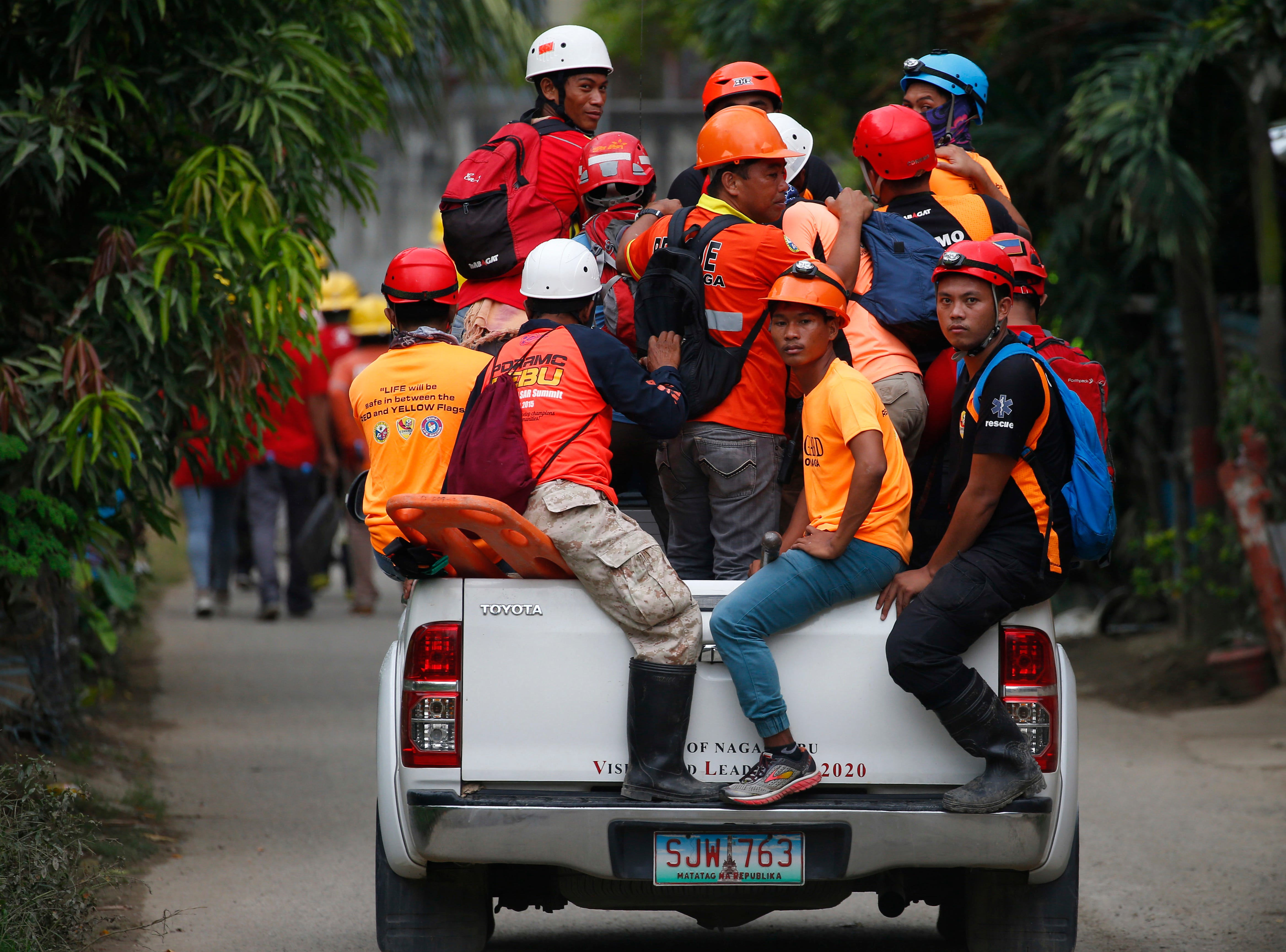 Rescuers continue operations for  a second day Friday, Sept. 21, 2018, following the massive landslide that buried homes under part of a mountainside City of Naga in the central Philippines, killing more than two dozen people. Several others were listed as missing.
