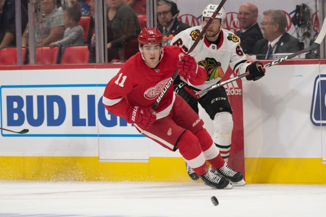 Detroit right wing Filip Zadina races toward the puck ahead of Chicago center Jacob Nilsson in the first period.