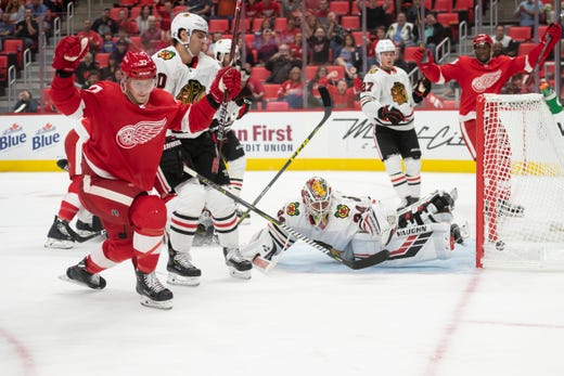 Detroit right wing Evgeny Svechnikov sends the puck past Chicago goaltender  Kevin Lankinen for the game 718d77ac1