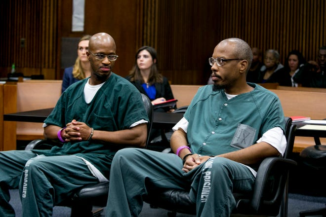 Justly Johnson (left) and Kendrick Scott (right) sit in court at the Frank Murphy Hall of Justice in Detroit on Friday, September 21, 2018. They are seeking a new trial for their conviction in a 1991 homicide.