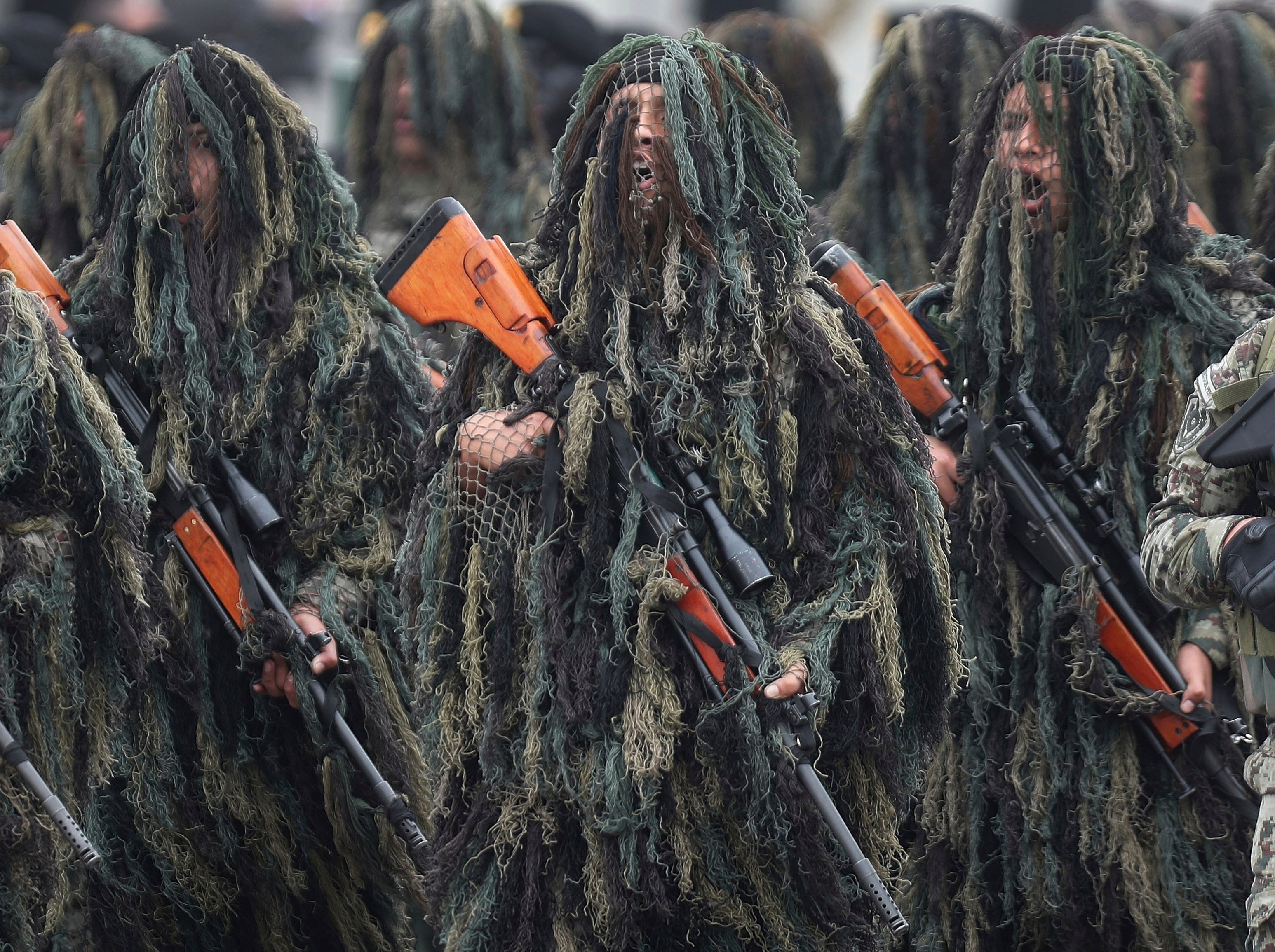 Members of the Peruvian Army Special Operations march in their ghille suits during a military parade marking the Armed Forces' anniversary, in Lima, Peru, Friday, Sept. 21, 2018.