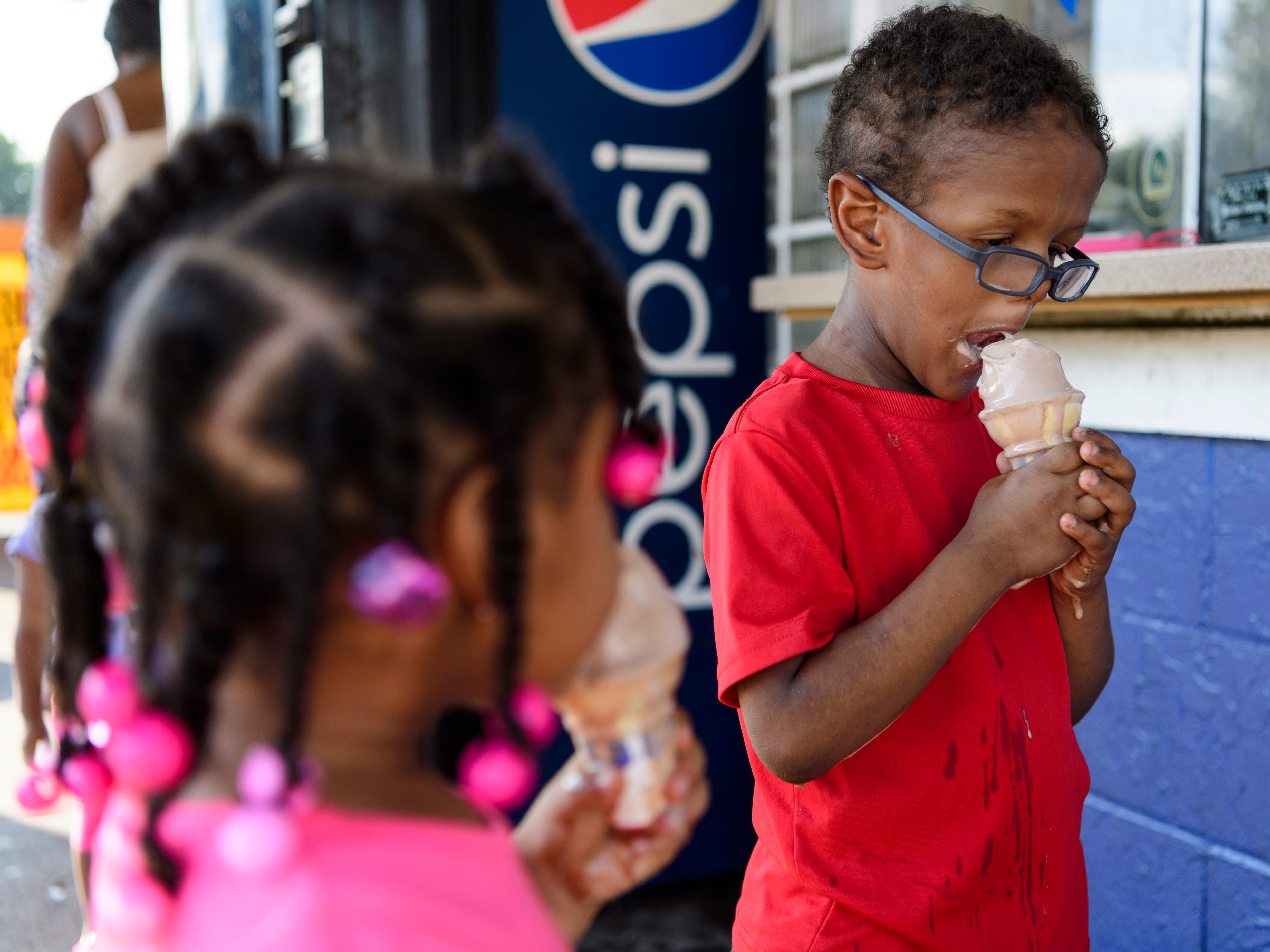 The ice cream is melting faster than Zarielle King, 3, left, and her brother Quay King, 5, can eat it at Zesto's Drive-In on Riverside Drive in Evansville, Ind., Thursday, Sept. 20, 2018. By Thursday afternoon, the temperature in the Tri-State area hit 98 degrees with a heat index of 104.