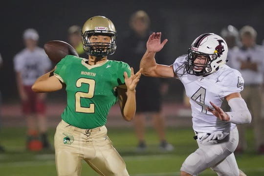 Oshkosh North quarterback Wesley Lo (2) drops back to pass against Oshkosh North on Sept. 20.