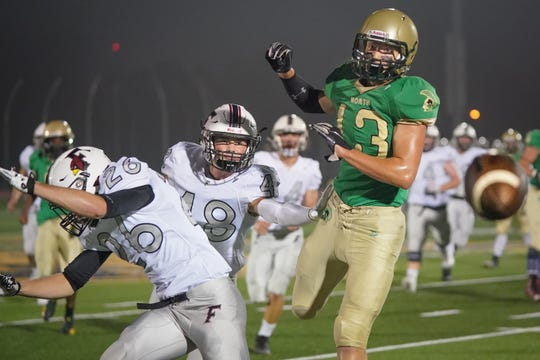Ethan Tessmer (13) of Oshkosh North watches as a pass falls incomplete in the first half against Fond du Lac.