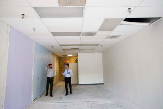 Sam Fischer, a physical therapist looking to open his own office, looks at a vacant commercial space with The Group Inc. commercial broker associate Rhett Strom, right, on Friday, Sept. 21, 2018, in Fort Collins, Colo.