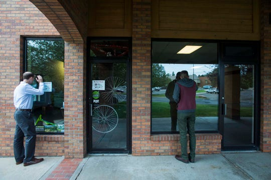 Sam Fischer, a physical therapist looking to open his own office, right, looks at a vacant commercial space with The Group Inc. commercial broker associate Rhett Strom on Friday, Sept. 21, 2018, in Fort Collins, Colo.