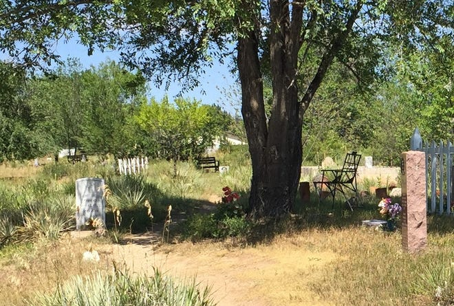 A metal chair that sat under a tree at Bingham Hill Cemetery for 30 years was stolen around Sept. 10.